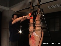 roped-asian-pregnant-slave-gets-wax-dripped-on-her