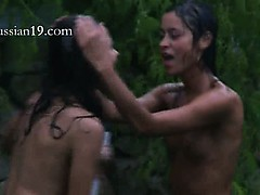 russian-girls-watersports-in-the-garden