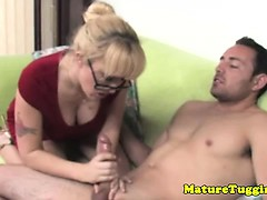 blonde-mature-with-spex-tugging-hard-cock