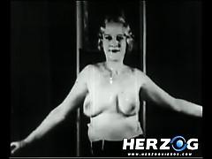 natural-blonde-makes-a-strip-show-in-20s-porn-film