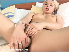 blonde-russian-fills-her-tight-pussy-with-a-big-brutal-dildo