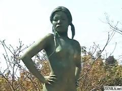 A living nude female Japanese garden statue
