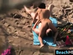 couple-doing-a-69-at-the-beach