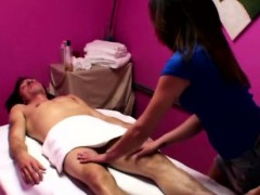 asian-masseur-tugs-her-clients-hard-cock