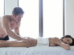pretty-brunette-girl-face-down-on-portable-massage-table