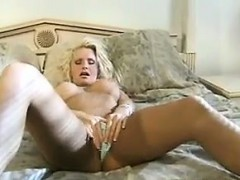 blonde-cougar-masturbating-with-her-toy