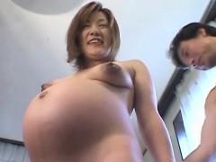 asian-milf-flashing-her-preggo-body