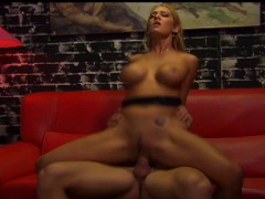 busty-blonde-gets-her-sausage-portion-on-a-red-couch