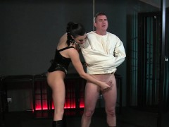 slave-in-straitjacket-gets-handjob-to-orgasm
