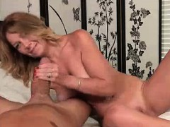 naughty milf finds him laying naked in her bed Handjob