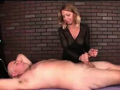 milf-masseuse-teases-client-s-cock-with-vibrator