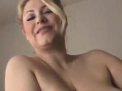 busty-mature-blonde-strips-and-masturbates