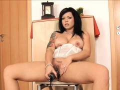 thick raven haired bitch slides in a big brutal dildo