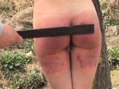 tied-to-a-tree-and-severely-spanked