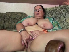 chubby-mature-lady-oiling-up-her-tits-and-toying-her-pussy