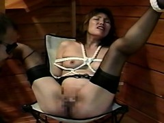 asian-bitch-has-needles-stuck-in-her-nipples