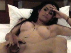 asian-tranny-posing-naked-on-bed-while-sucking-massive-dick