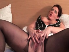 stockinged-mature-doing-herself-with-a-toy