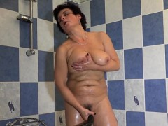 hot-granny-plays-with-her-big-tits