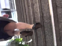 spy-cam-follows-a-chick-in-a-black-dress-and-nylons-as-she