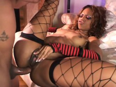 lustful-chocolate-babe-in-fishnets-feeds-her-hungry-ass-a-long-stick