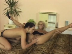 Sultry brunette fucks her blonde lesbian lover with a strap-on dildo