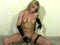bigtitted-blonde-shemale-gets-her-bigtits-messy-and-jerks