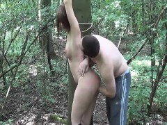publicly-fisting-his-slave-gf-tied-to-a-tree