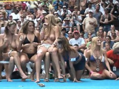 a-bunch-of-beautiful-babes-sit-around-in-bikinis-and-are-filmed