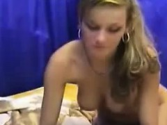 hot-blonde-babe-puts-on-the-dildo-display