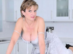 cheating-british-mature-lady-sonia-pops-out-her-giant-melons