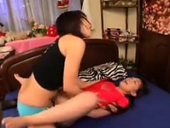 two-sweet-oriental-lesbians-explore-their-fantasy-with-stra