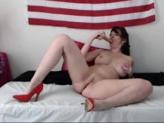 busty-webcam-milf-rides-her-dildo