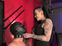 tattooed mistress punishing bonded male woman
