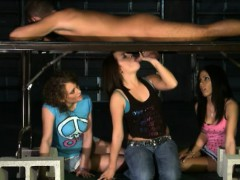 three-adorable-women-blowjob-cock-under-the-massage-table