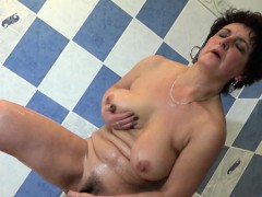 naughty-granny-enjoys-her-body-in-the-bathroom