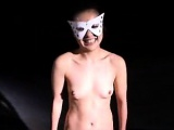 Masked Oriental ballerina showing off the sweet contours of