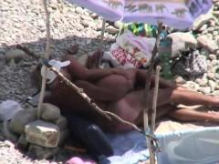 mature-couple-enjoying-sunny-days-on-beach