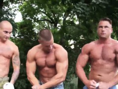 three-muscled-hunks-arm-wrestling-in-the-street