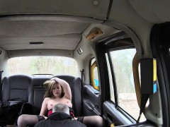 blonde lady makes need inside the taxi