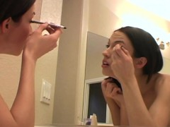 putting-on-her-makeup