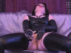 latex-babe-enjoys-her-see-through-dildo