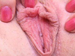ideal bitch is gaping slim vulva in closeup and cumming