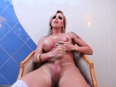 Stockinged shemale tugging cock in lingerie