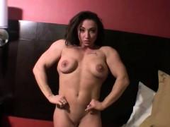 Naked Female Bodybuilder Posing in Bedroom