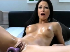 Beautiful brunette fucks pussy with sexmachine