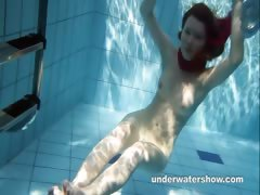 redhead-mia-is-tripping-underwater