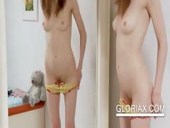teen-minx-gloria-switching-panties-in-the-mirror