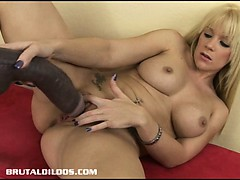 busty blonde riding a big brutal dildo