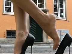 Woman In A Red Dress Walking Around In Heels